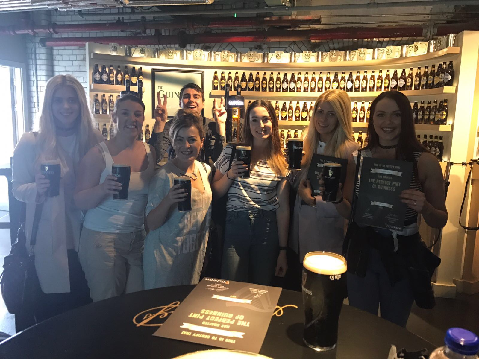 Guinness Storehouse pulling pints - Dublin