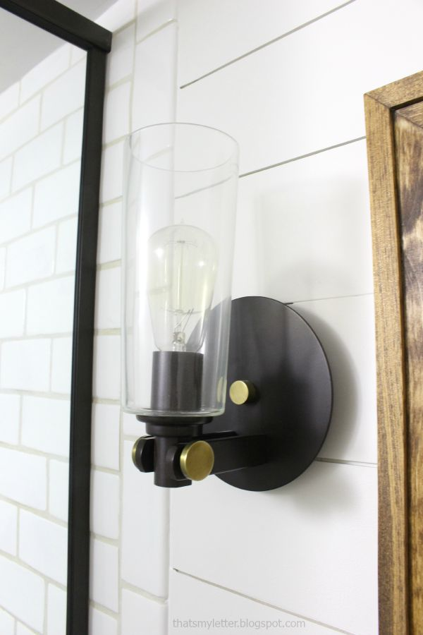 glass and dark metal circular sconces