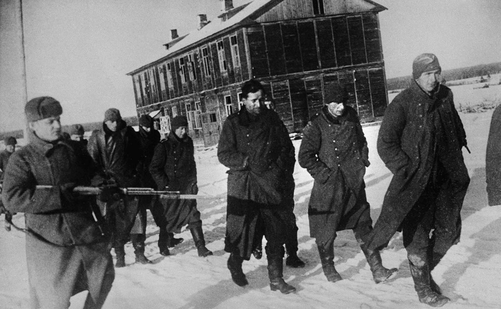Russian troops approach Moscow with German prisoners on February 10, 1942.