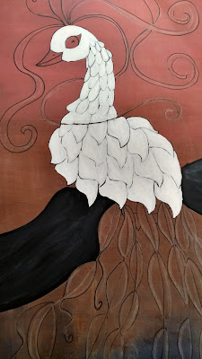 white paint on the upper peacock feathers and black on the tree branch