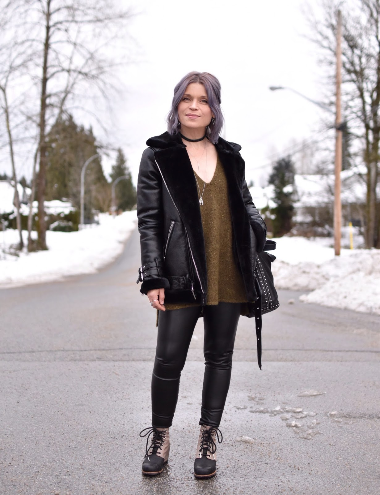 Monika Faulkner outfit inspiration - styling a tunic sweater with faux-leather leggings, wedge booties, and an aviator jacket