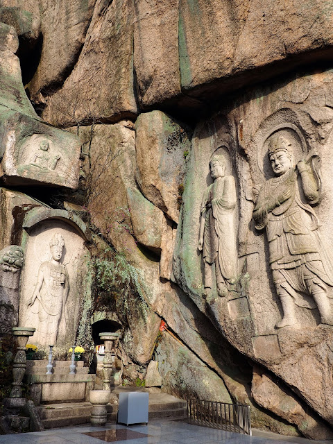 Buddhist carvings in the prayer area of Seokbulsa Temple, on Geumjeongsan Mountain, Busan, South Korea