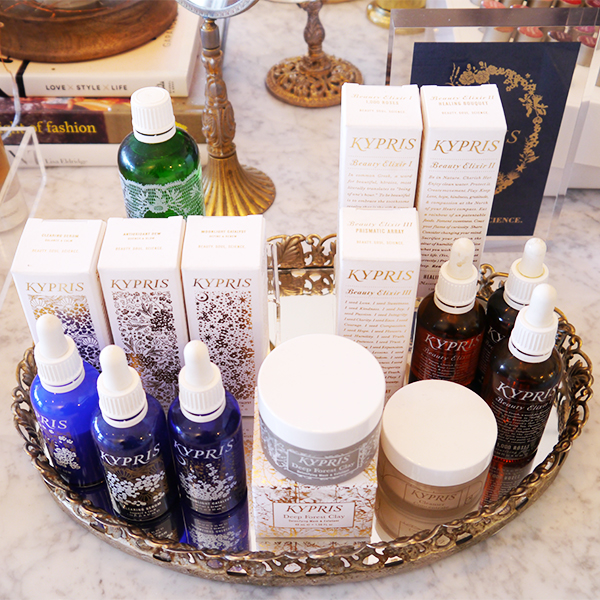 Kypris beauty products on a silver mirrored tray