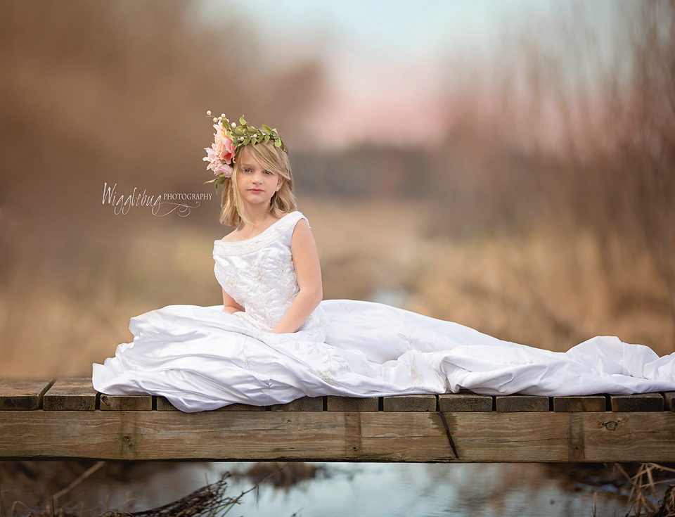 beautiful 7 year old girl in her mother's wedding dress| DeKalb, Sycamore, Photographer