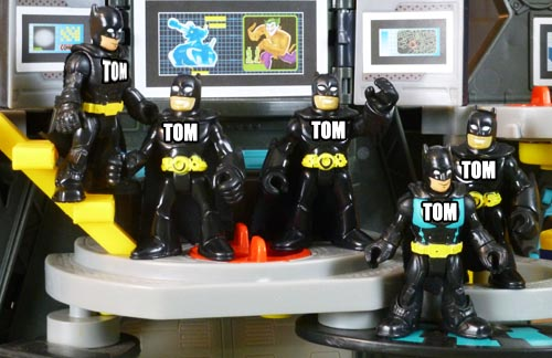 Batman toys with Tom transposed on the chest