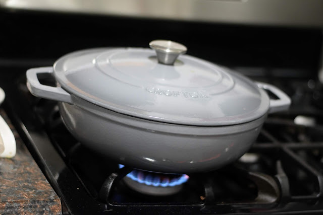 The pan, on the stove, with a lid on it.