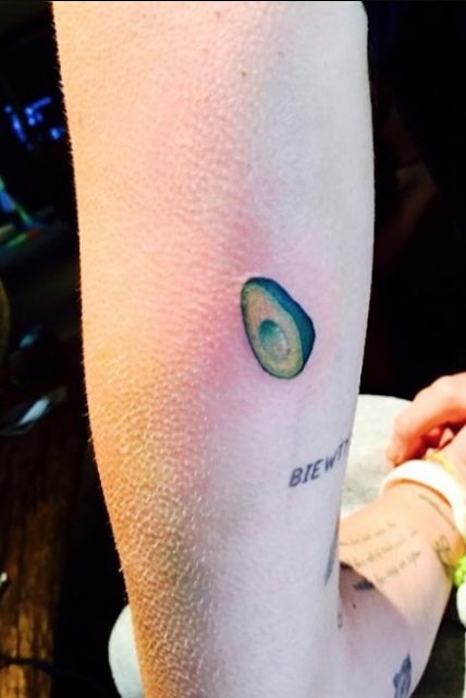 Miley Cyrus avocado Tattoo on her left arm