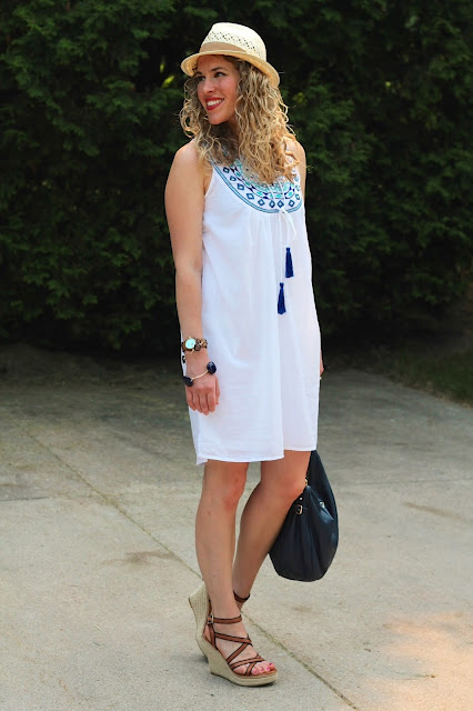 white embroidered dress, wedges, navy kate spade bag, straw fedora