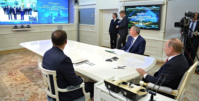 Video linkup with International Space Station and Vostochny Space Launch Centre. Credit: Kremlin.ru