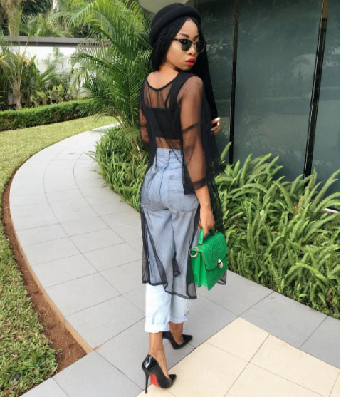 Photos: Mo'cheddah flaunts belly in veil dress and jean combo