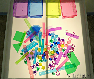 A simple color sorting activity for kids on the light table from And Next Comes L