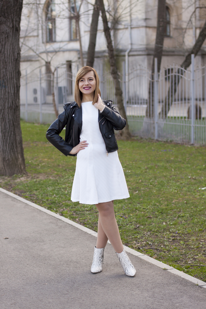 the white dress with the leather jacket