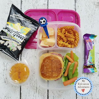Lunch box fun with a grilled reuben on a hamburger bun. In our @easylunchboxes #lunchboxideas