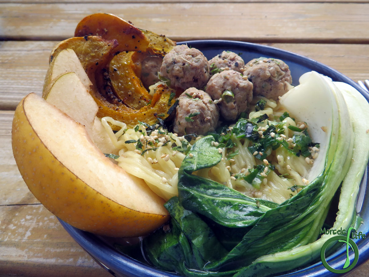 Morsels of Life - Pork Meatball Ramen - Fresh ramen, topped with ginger and green onion pork meatballs served in miso soup, then garnished with roasted winter squash for one scrumptious pork meatball ramen.