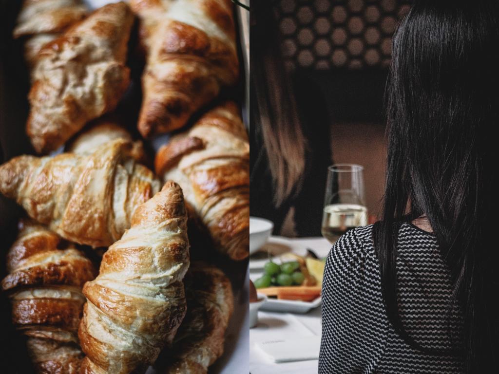 Croissants und Details des gedeckten Tisches