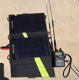 Photograph of the Nomand 7 Solar Panel and Kenwood TH-F6A tri-band amateur radio