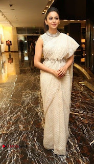 Actress Rakul Preet Singh Stills in White Dress at Winner Pre Release Function  0047.jpg
