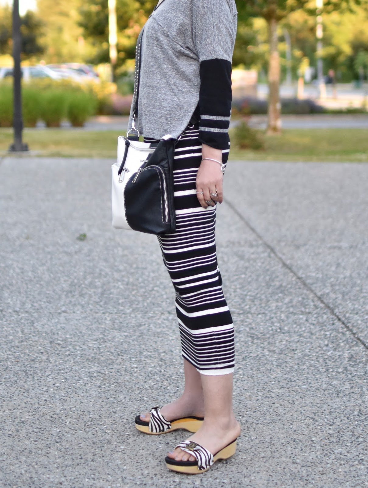 Monika Faulkner personal style inspiration - baseball tee, striped midi-length pencil skirt , Steve Madden cross-body bag, Dr. Scholl's-inspired sandals