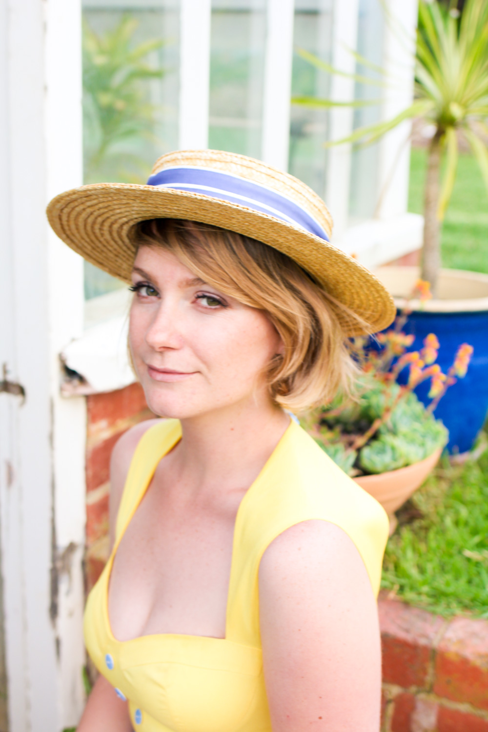 @findingfemme wears Nishe blue and yellow dress with vintage Laura Ashley straw boater and Forever New sandals at So Frenchy So Chic