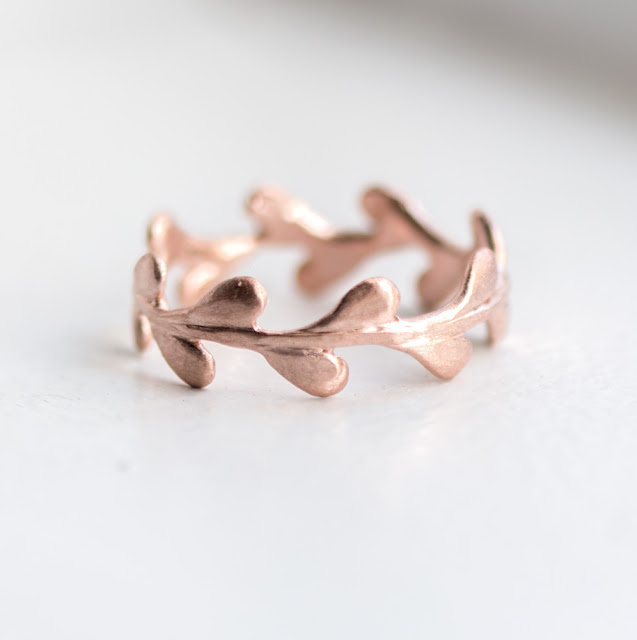 Handmade wisteria leaf eternity band shown in 14k rose gold with brushed matte finish.