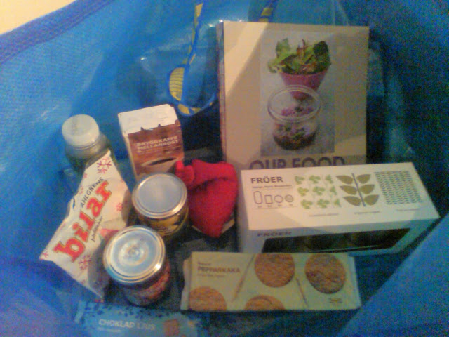 Selection of small Ikea products (sweets, biscuits, jams etc) in a blue Ikea bag