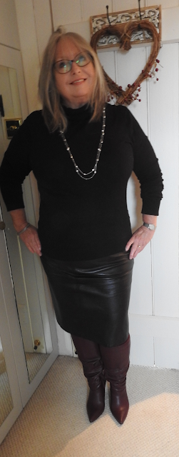Pouting-Pensioner-black-polo-leather-skirt-berry-knee-boots