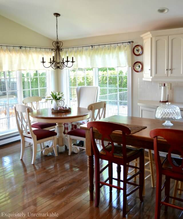 Red and White Farmhouse Kitchen  with round table and an island