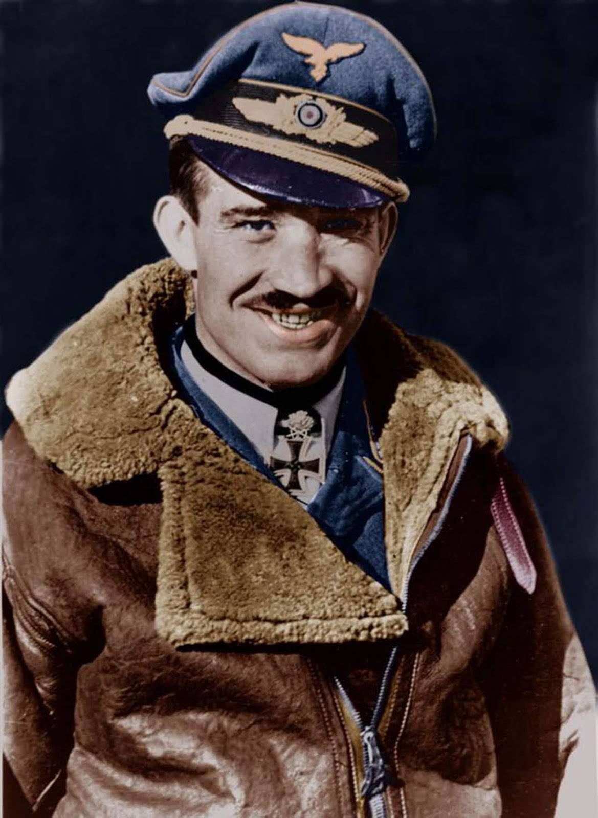 Adolf Galland looks so awesome in his bomber jacket - and that goofy grin shows why he was dynamite with the ladies, too.