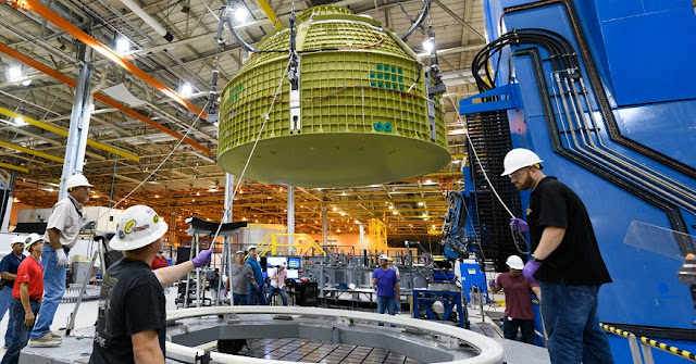 At the NASA Michoud Assembly Facility in Louisiana, Lockheed Martin technicians have completed construction of the first Orion capsule structure that will carry humans to deep space on Exploration Mission-2. Image courtesy of NASA.