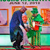 Picture of the century - Buhari bends down to assist Mrs Ganiyat Fawehinmi with an item that fell off her