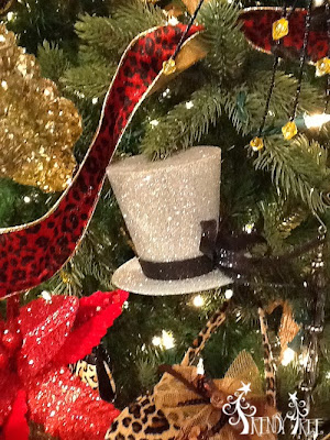 http://www.trendytree.com/raz-christmas-and-halloween-decor/raz-3-glittered-top-hat-gold-silver-black-christmas-ornament-set-of-3.html