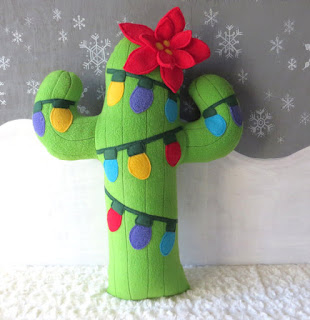 stuffed cactus with christmas lights from wild rabbits burrow etsy