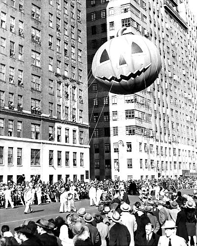 Watchers Lean From Windows In 1945 As A Mammoth Pumpkin Passes By The Macys Thanksgiving Day Parade