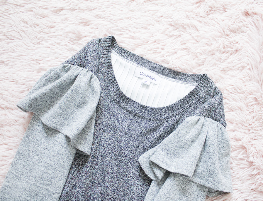 flatlay shoulder ruffle grey sweater