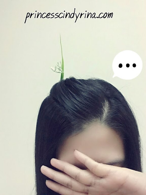 Girl posing with plant hair pin