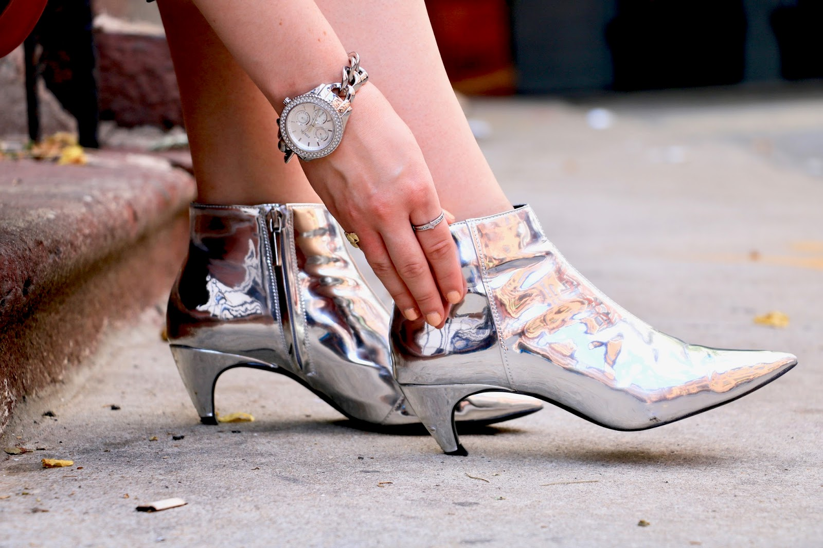 Fashion blogger Kathleen Harper wearing silver metallic booties from Zara
