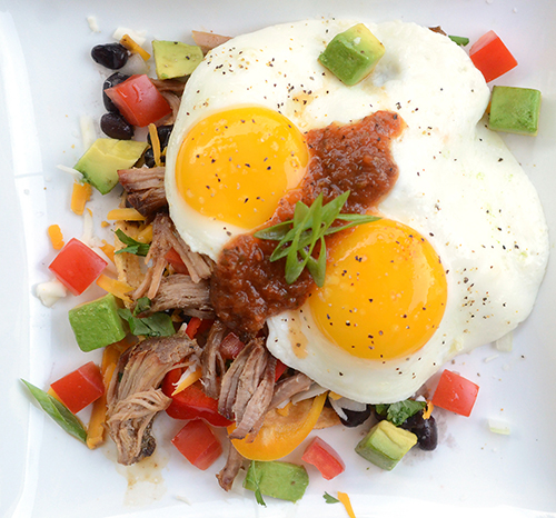 Easy huevos rancheros recipe with Smithfield tender Seasoned Carnitas pork shoulder, homemade salsa and fresh vegetables.