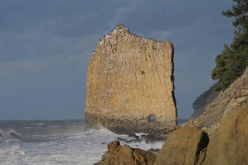 Sail Rock, also known as Parus Rock  is a natural monument of natural sandstone monolith in the Krasnodar Territory, located on the Black Sea coast in Krasnodar Krai, Russia, 17 km south-east of Gelendzhik, near the village of Praskoveevka and about 500 meters along the seashore.