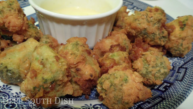 Broccoli florets dipped in batter and tossed in seasoned flour, then quickly deep fried - a crunchy on the outside, tender on the inside appetizer.