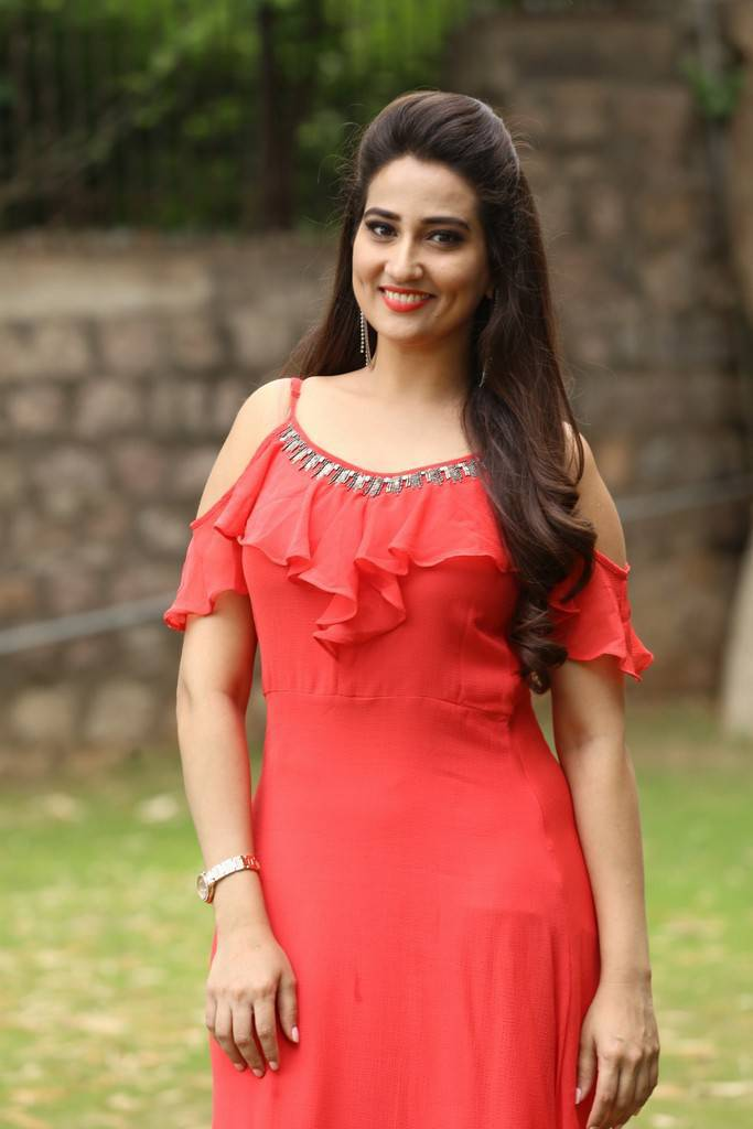 Telugu TV Anchor Manjusha Long Hair Stills In Pink Dress At Trailer Launch