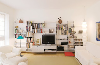 wall mounted sectional shelving feat white sofa and best rug beside medium floor lamp