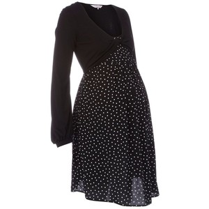 52ae0d730b775 This black jersey dress from Red Herring Maternity features a white polka  dot design and a pleated flare skirt.
