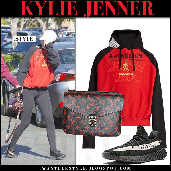 Kylie Jenner in red and black hoodie vetements  and black leggings what she wore streetstyle