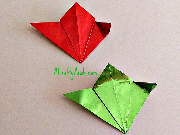 Insert Them Into Each Other Placing The Small Folds Over Next Piece To Bind Together Grab And Fold Top Right Triangle