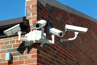 Several camera mounted on a school building.
