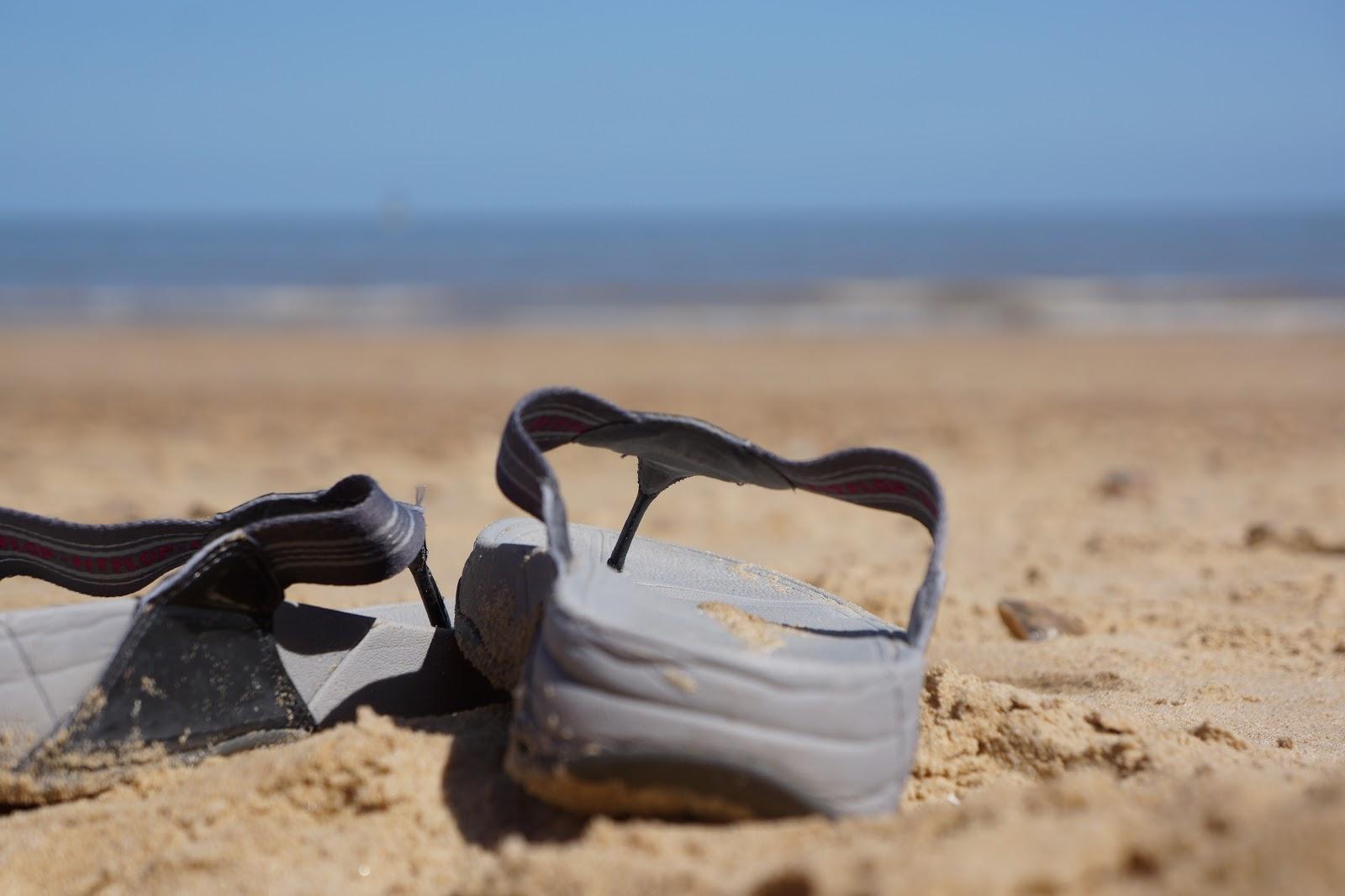 fit flops on sandy beach