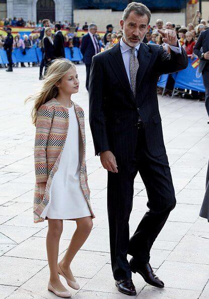 Queen Letizia wore grey coat dress, Crown Princess Leonor wore a Mango pattern jacket and Infanta Sofía wore a coral Mango dress