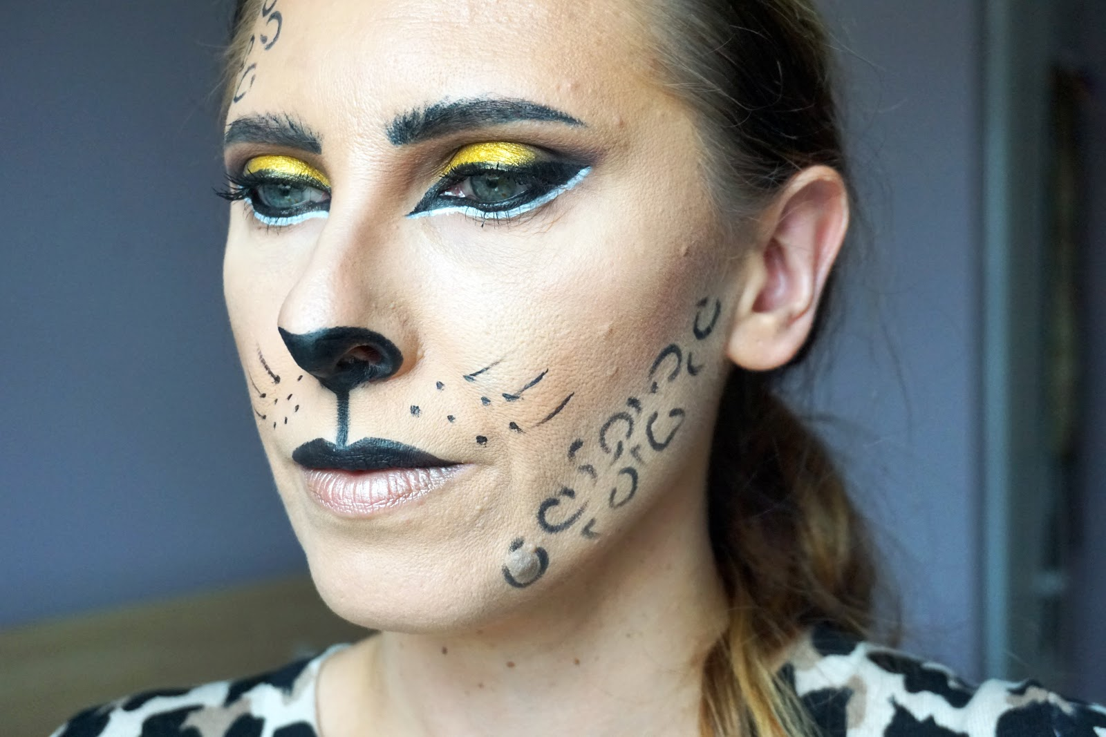 Feline Fierce With Boots, easy Haloween leopard makeup look