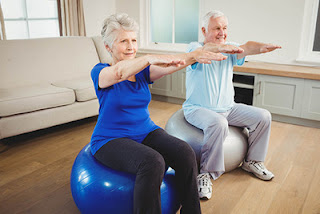 Image of an old couple exercising together