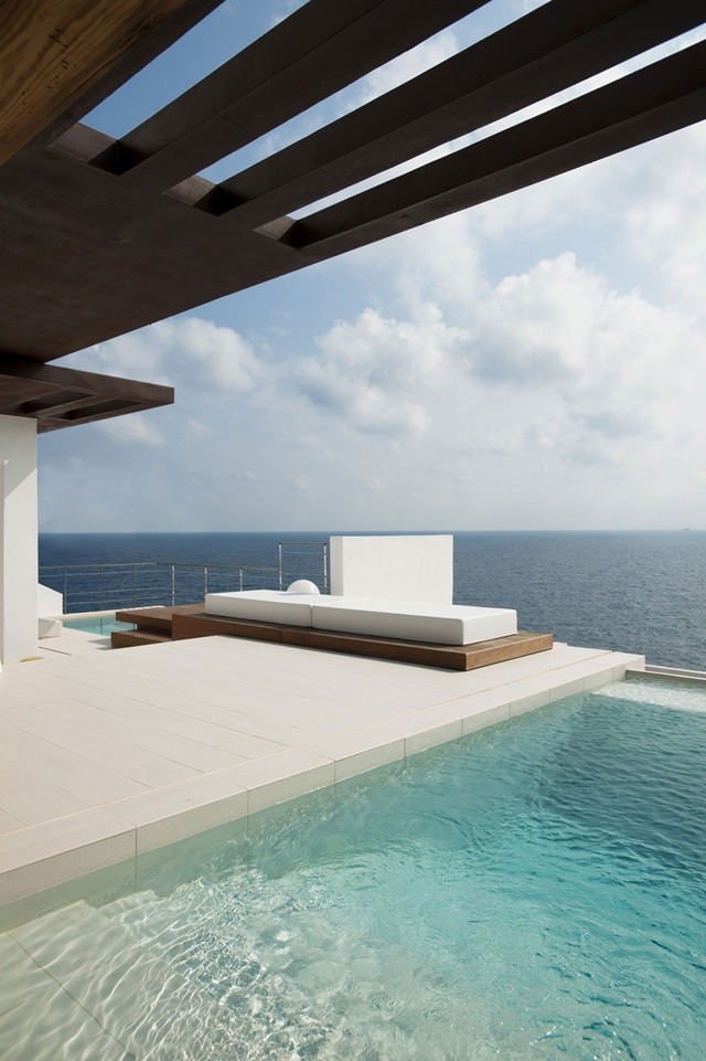 Modern outdoor bed by the swimming pool